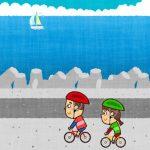 海岸をサイクリングする男女