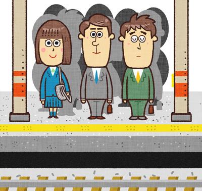 駅のホームで電車を待っている人たち
